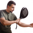 Paddle tennis player on white — Stock Photo