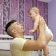 Modern father in bedroom with baby — Stock Photo