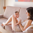 Relaxing on sofa — Stock Photo