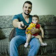 Stock Photo: Father and baby watching tv