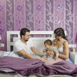Family at bedroom. — Stock Photo