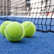 Paddle tennis balls in court — Stock Photo