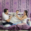 Family playing in bedroom — Stock Photo