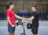Paddle tennis hand shake — Stock Photo