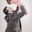 Stock Photo: Father lifting baby