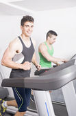 Two guys on treadmill — Stock Photo