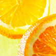 Orange slices in ice water - Stock Photo