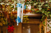 Chinese wind chimes with sakura flowers, motion blur — Stock Photo