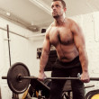 Group with dumbbell weight training equipment on sport gym — ストック写真