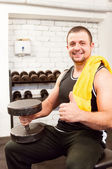 Group with dumbbell weight training equipment on sport gym — Stock Photo