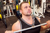 Man with weight training equipment on sport gym club — Zdjęcie stockowe