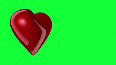 červené srdce, otáčení na greenscreen pozadí — Stock video