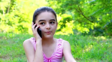 Smiling teenage girl talking on mobile phone — Stock Video
