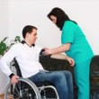 Stock Video: Blood pressure check for disabled young adult