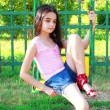 Stock Video: Sad young girl on swing