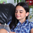 Smiling girl listening to music on tablet pc — Stock Video #26417115