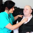Stok video: Nurse consulting sick senior man