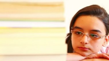 Girl Overwhelmed with School Work and Reading Books