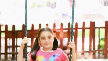 Little girl swinging — Stock Video
