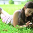 Stock Video: Girl playing with smartphone