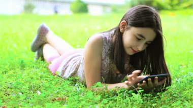 Girl playing with smartphone — Stock Video