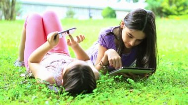 Girls playing on digital tablet and smartphone — Stock Video