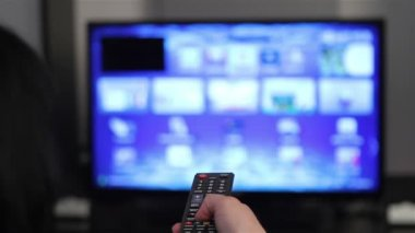 Smart tv and young woman hand pressing remote control — Stock Video