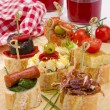 Spanish Cuisine. Tapas. Tray of montaditos. - Stock Photo
