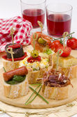 Spanish Cuisine. Tapas. Tray of montaditos. — Stock Photo
