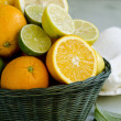Citrus fruits in a basket. — Stock Photo