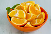 Sliced oranges in a bowl — Stock Photo