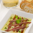 Stock Photo: Spanish Cuisine. Marinated anchovies. Anchoas en aceite.