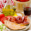 Stock Photo: Spanish Cuisine. Tomato bread and Serrano Ham. Pamb tomaquet i
