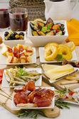 Spanish Cuisine. Variety of tapas on white plates. — Stock Photo