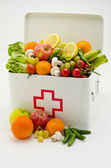 Healthy food. First aid box filled with fruits and vegetables. — Stock Photo