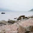 Fishing by boat on Loch Ness - Stock Photo