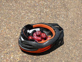 Plums and helmet — Stock Photo