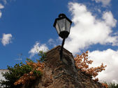 Lamppost and clouds — Stock Photo