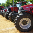 Red tractors and combine — Stock Photo