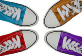 Sneakers blue, orange, red and — Stock Photo
