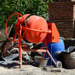 Orange concrete-mixer — Stock Photo