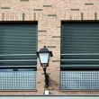 Stock Photo: Two windows and lamppost