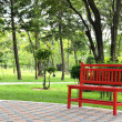 Red bench in garden — Stock Photo