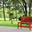 Red bench in garden — Stock Photo #32322771