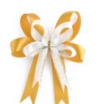 Shiny gold Christmas bow isolated on white — Stock Photo