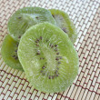Dried Kiwi on wood background — Stock Photo #32323817