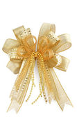 Shiny golden Christmas bow isolated on white — Stock Photo