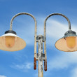 Stock Photo: Two lampposts on sky