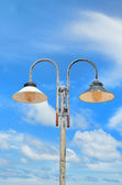 Two lampposts on sky — Stock Photo