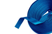 Blue ribbon roll on a white background — Stock Photo